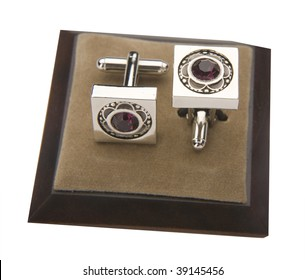 cuff links on white background