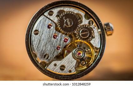 Cufflink clock mechanism, working, steampunk vintage retro style.