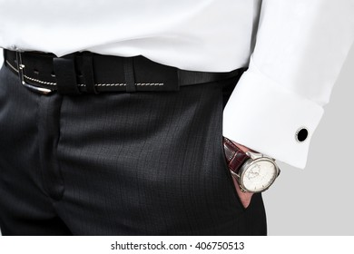cufflinks business man holding his hand in his pocket, men's style. close up, background