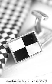 Men's cufflinks with tie background