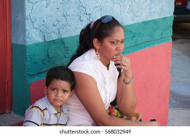 CUIDAD BOLIVAR, VENEZUELA, 19 NOVEMBER 2010: hispanic son and his mother portrait