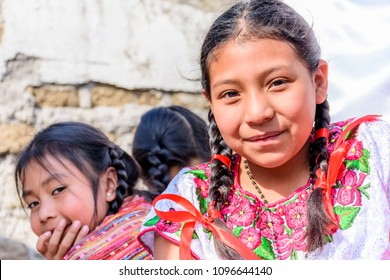 Cuidad Vieja,, Guatemala -  December 7, 2017: Traditionally dressed indigenous girls in parade celebrating Our Lady of the Immaculate Conception Day in town near Antigua, Guatemala.