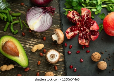 Cuisine, background of vegan food, avocado, pomegranate, green beans mushrooms, broccoli mushrooms, onions, nuts, greens. Clean and healthy food, detox, sports and diet