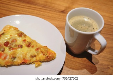Cuisine and Food, A Cup of Espresso Coffee Served with Delicious Pizza for A Morning Breakfast.