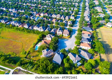 Cul de sac in the corner of a neighborhood in Austin Texas suburbia aerial drone view high above houses