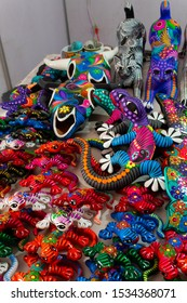 Culiacan, Sinaloa, Mexico - October 16 2019: Beautiful Mexican indigenous crafts of alebrijes and skulls of the day of the dead