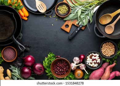 Culinary background with kitchen utensils and various culinary ingredients, healthy vegetarian protein sources, vegetables and spices for cooking healthy food