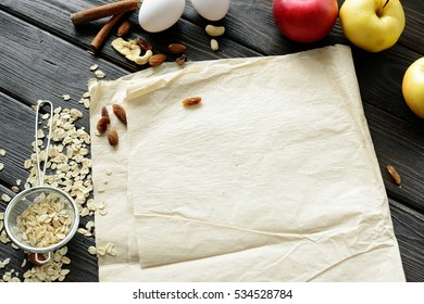 culinary background for recipe of baking. Apples, oatmeal and eggs. Flat lay,