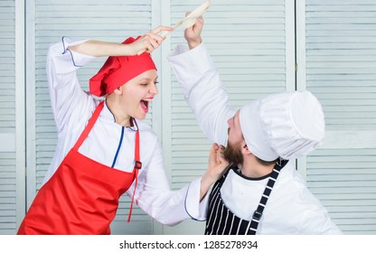 Culinary battle of two chefs. Couple compete in culinary arts. Kitchen rules. Who cook better. Culinary battle concept. Woman and bearded man culinary show competitors. Ultimate cooking challenge.