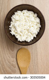 Culinary cottage cheese in a clay bowl for toppings.
