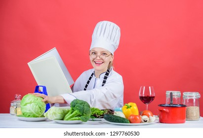 Culinary expert. Female in hat and apron knows everything about culinary arts. Woman chef cooking healthy food. Girl read book best culinary recipes. Culinary education concept. Improve cooking skill.