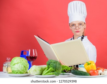 Culinary expert. Woman chef cooking healthy food. Girl read book top best culinary recipes. Traditional cuisine. Culinary school concept. Female in hat and apron knows everything about culinary arts.