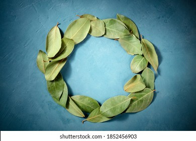 Culinary frame with a place for text. A wreath of bay leaves, shot from the top