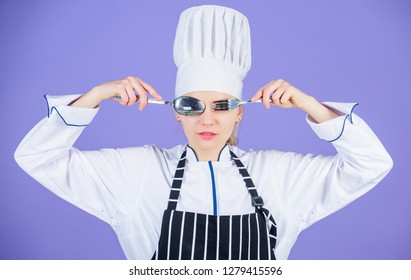 Culinary school concept. Woman professional chef hold utensil spoon fork having fun. Time to eat. Appetite and taste. Traditional culinary. Professional cook of culinary school. Culinary arts academy.