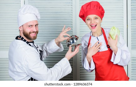 Culinary surprise concept. Delicious meal. Woman and bearded man culinary show team. Ultimate cooking challenge. Culinary battle of two chefs. Kitchen rules. Couple compete in culinary arts.