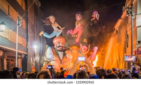 Cullera, Valencia / Spain - 02 19 2017: People, tourists are looking at the burning Falla Taut into the fire during la Crema final event during Las Fallas festival in Valencia Community in Spain.