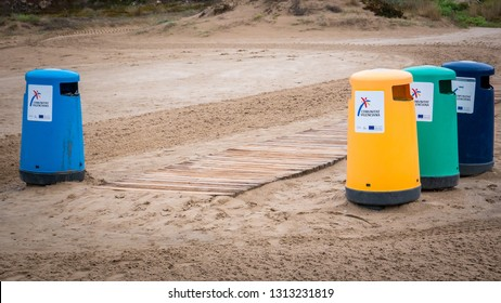 Cullera, Valencia / Spain - October 30, 2018: Wastebaskets on the Cap Blanc beach and the Mediterranean Sea close to Punta Negra. This beach is located in the seaside holidays town of Cullera.