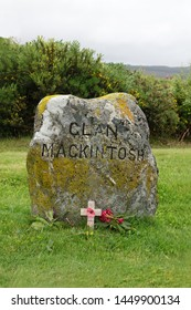 Culloden, Scotland - June 11, 2019: A CLAN MACKINTOSH stone marker indicates the area where casualties from the clan may have been buried following the Battle of Culloden on April 16, 1746.