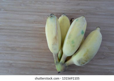 Cultivated banana On the wood floor