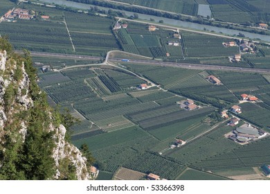 Cultivated fields in valley of the Adige