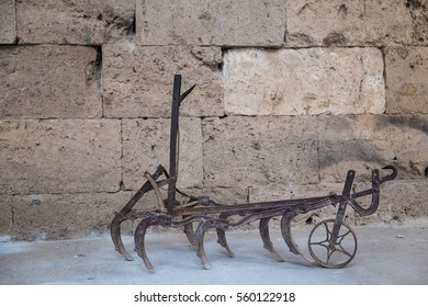 Cultivator Tiller plough handle agricultural farming utensil tools in Caravanserai, old and rusty steel equipment