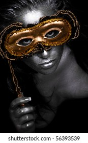 Cultural symbol of actress with mask in dark