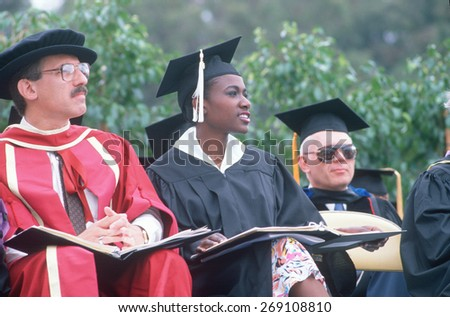 Culturally diverse faculty in formal robes at a graduation, UCLA, Los Angeles, CA