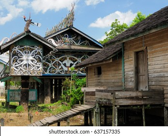 The culture and beliefs of the island Borneo. Traditional Dayak tribal culture. Decorated front of Dayak house - long house. Kalimantan, Indonesia