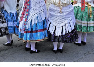 Culture of Hungary. Traditional Folklore Costume of Tamási. Folk dancing girls in traditional dresses. Colorful And Close Up Background.