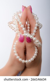 cultured pearls presented with nails painted pink