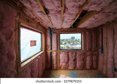 Culver City, California - April 28, 2018. Drywall installation after thermal insulation installed in a new construction building.