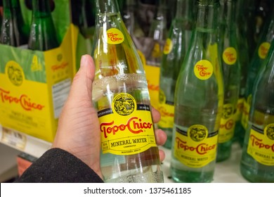 Culver City, California/United States - 4/5/19: A hand holds a bottle of Topo Chico