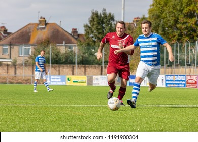 Culver Road, Lancing, UK; 30th September 2018; Two Players Run After the Ball During  Amateur Football Match Between Hillside Rangers FC v Horsham Crusaders FC