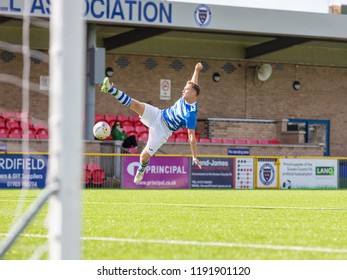 Culver Road, Lancing, UK; 30th September 2018; Player Attempts Spectacular Kick Near the Goal During  Amateur Football Match Between Hillside Rangers FC v Horsham Crusaders FC