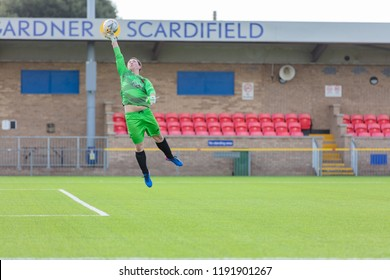 Culver Road, Lancing, UK; 30th September 2018; Goalkeeper Jumps and Stretches to Make a Save During  Amateur Football Match Between Hillside Rangers FC v Horsham Crusaders FC