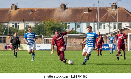 Culver Road, Lancing, UK; 30th September 2018; Player Attempts a Tackle During  Amateur Football Match Between Hillside Rangers FC v Horsham Crusaders FC