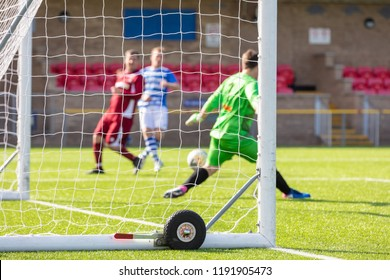 Culver Road, Lancing, UK; 30th September 2018; Unfocused View Partially Through Goalnet of Goalkeeper Making Save  During  Amateur Football Match Between Hillside Rangers FC v Horsham Crusaders FC