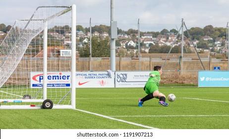 Culver Road, Lancing, UK; 30th September 2018; Goalkeeper Attempts to Save a Shot During  Amateur Football Match Between Hillside Rangers FC v Horsham Crusaders FC