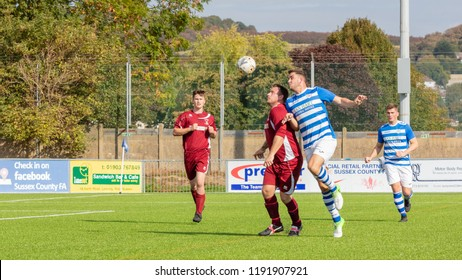 Culver Road, Lancing, UK; 30th September 2018; Two Players Challenge for a Ball in the Air During  Amateur Football Match Between Hillside Rangers FC v Horsham Crusaders FC