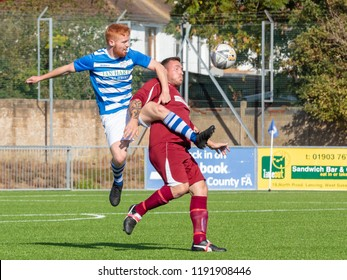 Culver Road, Lancing, UK; 30th September 2018; Two Opponents Chsllenge for the Ball During  Amateur Football Match Between Hillside Rangers FC v Horsham Crusaders FC
