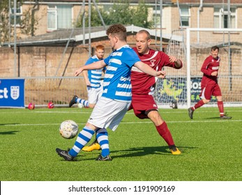 Culver Road, Lancing, UK; 30th September 2018; Player Strikes Ball While Being Watched by an Opponent During  Amateur Football Match Between Hillside Rangers FC v Horsham Crusaders FC