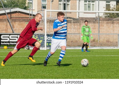 Culver Road, Lancing, UK; 30th September 2018; Player Dribbles Football Whilst Chased by Opponent During  Amateur Football Match Between Hillside Rangers FC v Horsham Crusaders FC