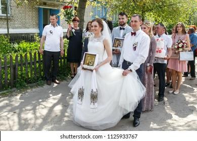 Cuman, Volyn / Ukraine - April 29 2018: Bride and groom before orthodox wedding ceremony before church