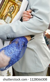 Cuman, Volyn / Ukraine April 29 2018: Ukrainian wedding tradition - mom puts the grain into the pocket of groom suit