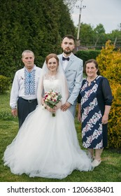 Cuman, Volyn / Ukraine - April 29 2018: Groom and bride with guests posing at park