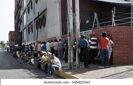 Cumana, Venezuela - July 27, 2019: people in line waiting to buy food from store