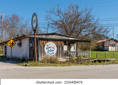 Cumberland County, Tennessee / USA - March 17, 2019: An old store with an antique Pure Gasoline sign out front. Rick's General & Thrift Store looks to have had many uses over the years