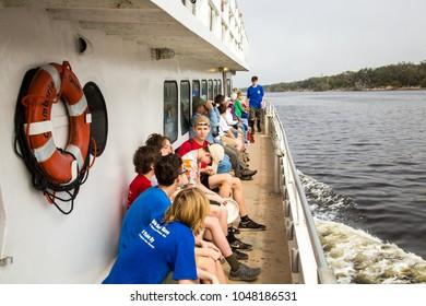 Cumberland Island, Georgia - 2/19/2018: A group of tourists on a tour boat, Cumberland Island.