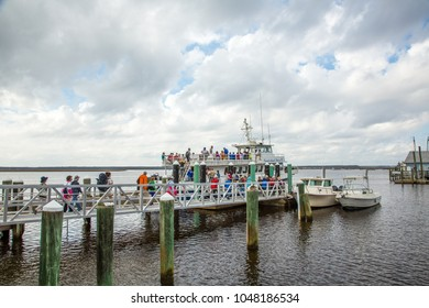 Cumberland Island, Georgia - 2/19/2018:  A group of tourists loading on a tour boat to view Cumberland Island Florida from the water.