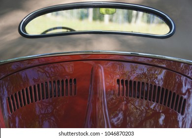Cumberland, Rhode Island/USA- August 20, 2017:  Looking into, and through, the rear window of a vintage red Volkswagen beetle.